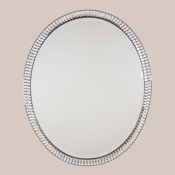 An oval mirror with a frame of rectangular baguette-cut mirror glass brilliants. Early 20th century.