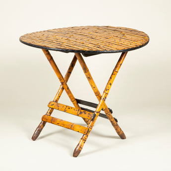 A circular split bamboo folding table, early to mid-20th century, French.