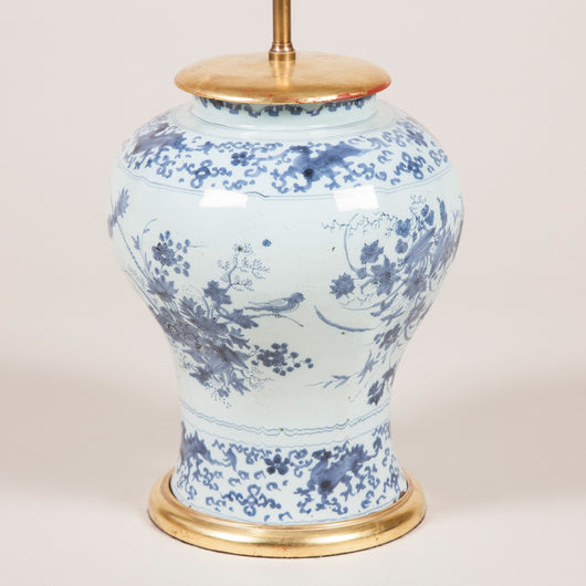 An early 18th century Delft vase with blue and white floral decoration, wired as a lamp.