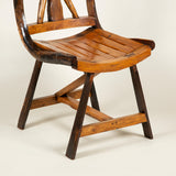 A pair of mid-20th century rustic Cotswold School side chairs.