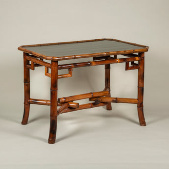 A 19th century French bamboo centre table with an interlaced cross-stretcher and a dark olive-green lacquered top with canted corners, circa 1880.