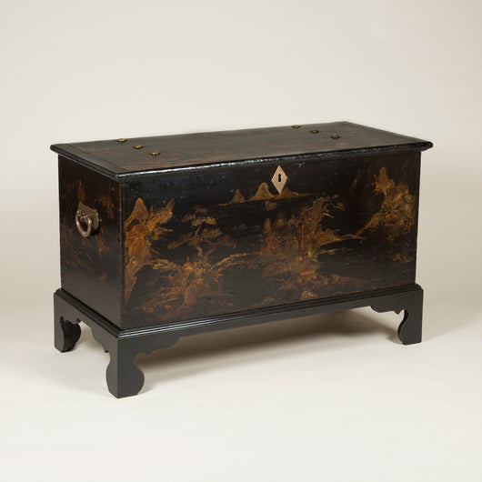 An 18th century black lacquered and gilt coffer, probably made in China for the European market, on a modern stand with bracket feet.