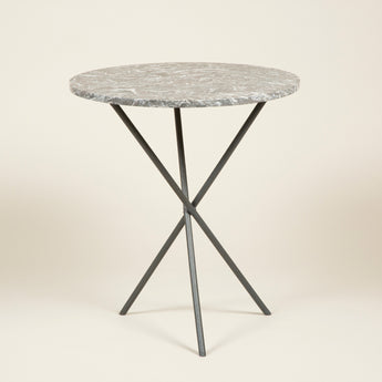 A small round table with a cast iron tripod base and a figured grey marble top. Continental, mid-20th century.
