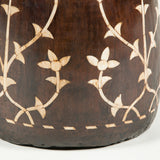 An Indian hardwood pot with inlaid bone decoration in the form of stylized flowering stems. Wired as a lamp.