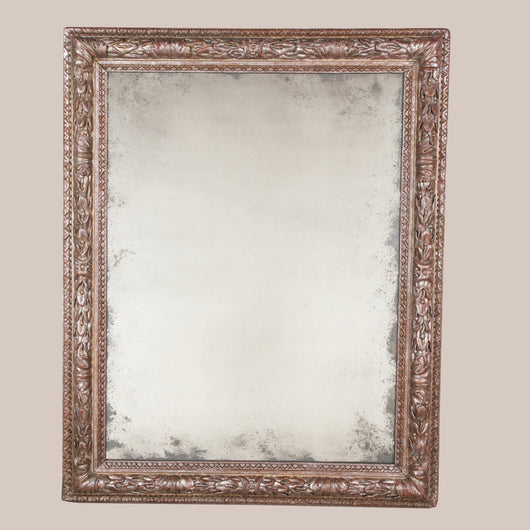 A large, rectangular silver gilt carved wood mirror. The frame 18th century Italian with a later plate.