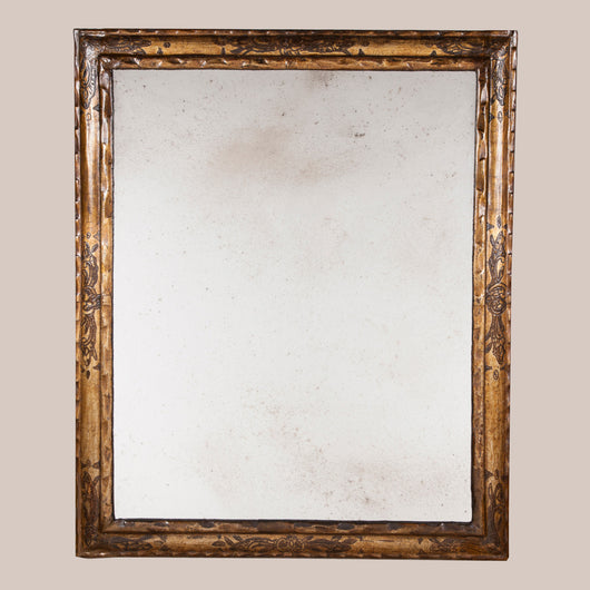A large 18th century Spanish giltwood frame decorated with impressed ...