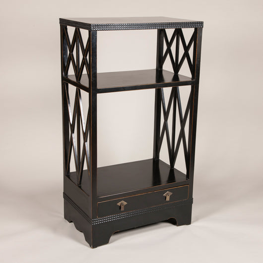 An ebonised Secessionist two tier etagere with a plinth base and x-frame supports, Austrian early 20th century.