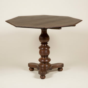 An octagonal teak pedestal table with a turned support. Sinhalese, 19th century.