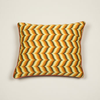 A rectangular cushion made up from an antique Bargello-work panel in a stylized feather pattern.