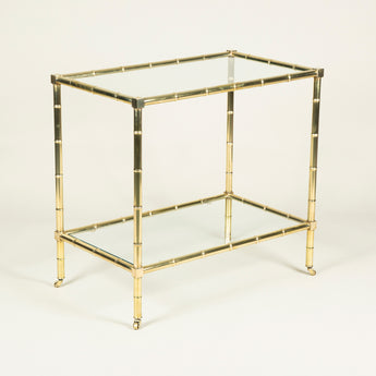 A mid-20th century French brass framed drinks table with two inset glass tiers.