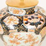 A vase lamp in the Imari pallette with reserves decorated with birds and flowers. 19th century, rewired.