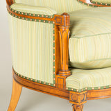 A small Louis XVI style cherrywood bergere. French 19th century.