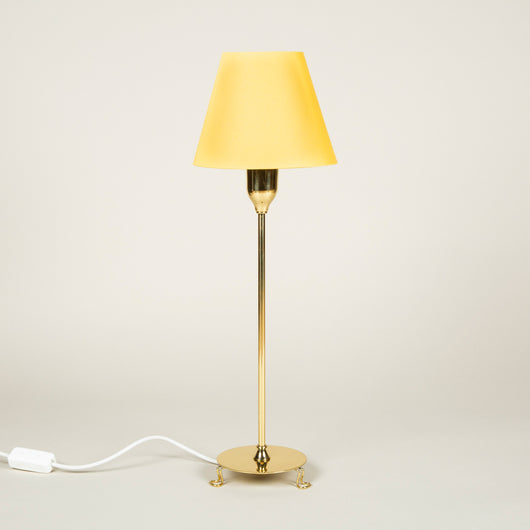 A pair of brass Svenskt Tenn table lamps and shades, wired for the UK.