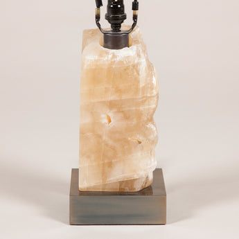 A block of rock crystal mounted on a brass base, wired as a lamp; modern, £950.00 + vat.