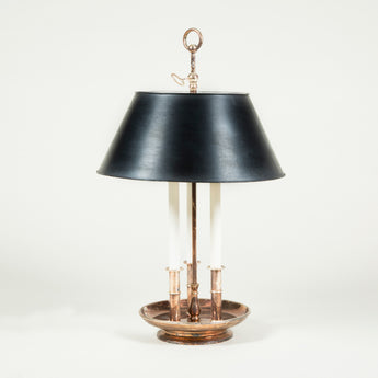 A silver plated three branch bouillotte lamp with a tole black shade.