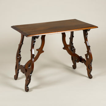 A Spanish walnut rectangular table in the early 18th C. style with shaped and pierced end supports. Probably early to mid 20th century.