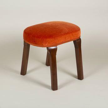 A George II mahogany stool, rectangular with rounded corners, with an upholstered seat and wide rounded legs, circa 1740.