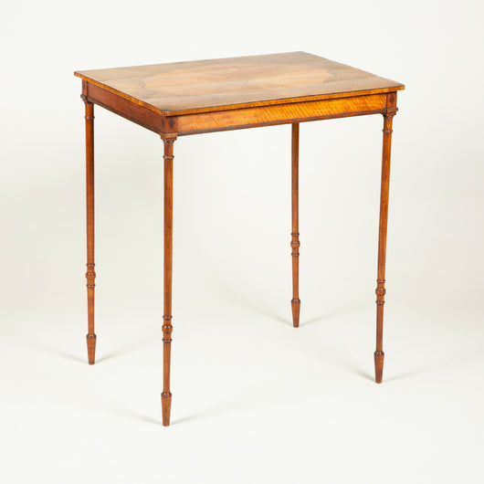 A Sheraton period rectangular mahogany table with marquetry top and slender turned legs, circa 1790.