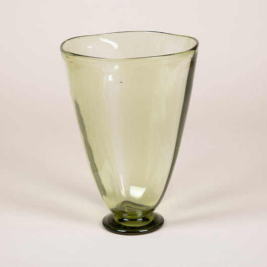 A tapering green glass vase by Whitefriar's.