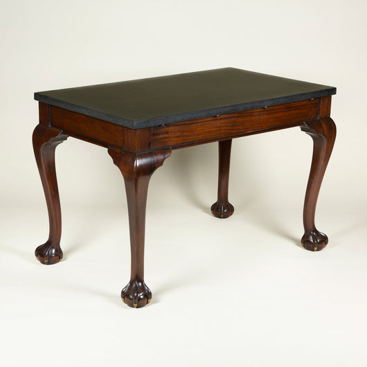 A good pair of rectangular mahogany side tables with cabriole legs and ball and claw feet and black fossil stone tops. 19th century in the mid-18th century style, the tops replaced.