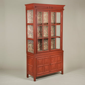 A 19th century American 'tramp-work' display cabinet, the upper part glazed at the sides as well as the front, and the interior re-lined with hand-marbled paper.