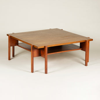 A mid-20th century Danish square teak coffee table with an undertier and pairs of off-set square section legs to each corner.