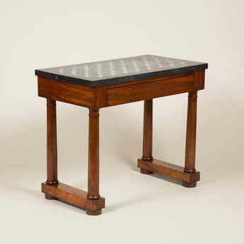 A William IV mahogany side table with column supports and a geometric inlaid marble top, circa 1830.