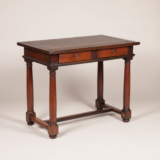A rectangular walnut side table with two frieze drawers and four column legs with block feet joined by cross stretchers. 18th century probably Italian. Lovely colour and patination.