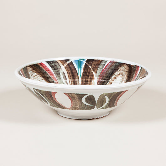 An Aldermaston pottery bowl with a red, grey and blue glaze, 20th century.