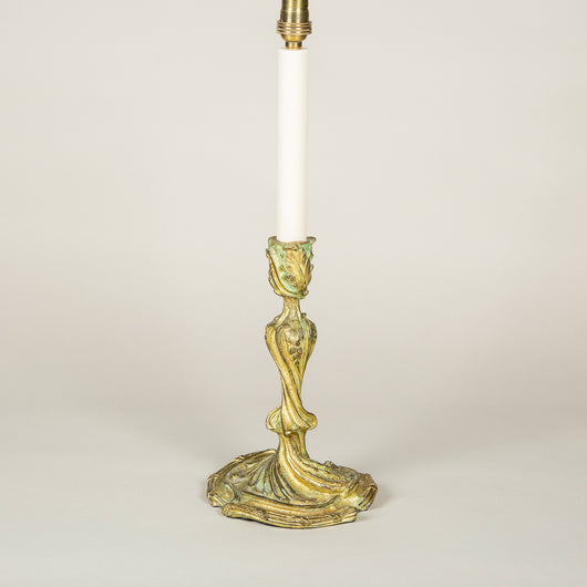 A pair of 19th century French rocaille gilt brass candlesticks wired as lamps.