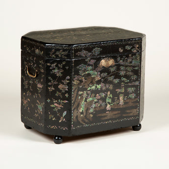A late 18th or early 19th century lac burgaute tea box with mother-of-pearl decoration.