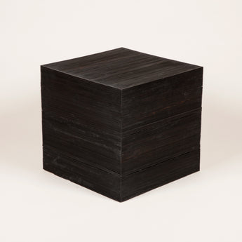 A pair of reeded ebony cubes