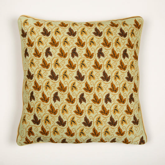 An archive Colefax needlepoint of leaves and scrolls backed with fawn velvet made up as a cushion.