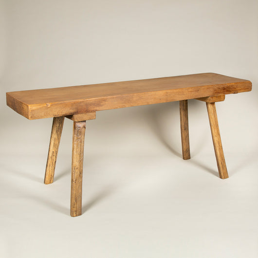 A polished fruitwood shepherd's table with a thick plank top and four splayed legs. Early to mid-20th century, East European.