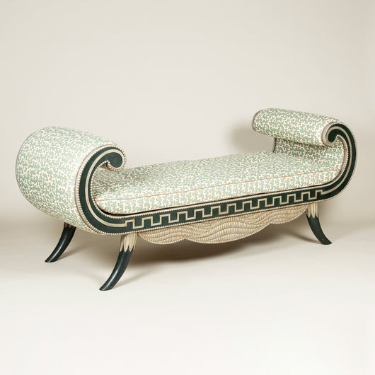 A spectacular Egyptian Revival style painted and silvered daybed with over-scrolled ends. Mid-20th century.