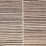 A transversely striped joined kilim strip rug in black and white natural wool. Persian Mazandaran, early 20th century.