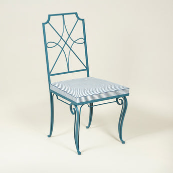 A pair of painted wrought iron side or dining chairs with upholstered seats. French, 1940's, repainted.