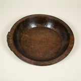 A large circular wooden bowl from N.E. India. 20th century.