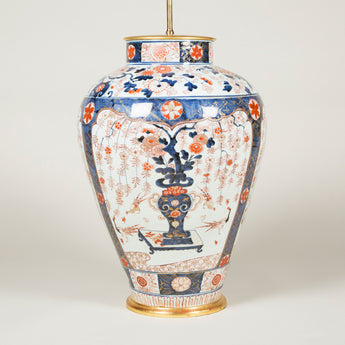 A very large  17th century Japanese Imari vase decorated with flowering tress in vases, wired as a lamp.