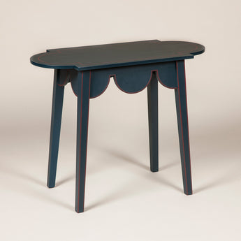 A small D-end table with a scalloped frieze. Made to order to any finish and finish - price on quotation.