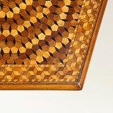 A pentagonal tripod pedestal table with intricate geometric marquetry top and oak base. 19th century.