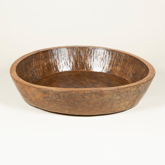 A very large circular wooden bowl from N.E. India. 20th century.