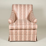 A Sibyl Colefax & John Fowler Brook armchair covered in 'Leopard Stripe'.