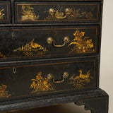 A George II black and gilt japanned bureau bookcase, circa 1740, the upper section with original mirror glass panels.