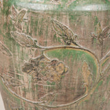 A 19th Century Anamese large green glazed pottery jar with low relief decoration of scrolling foliage with flowerheads, interspersed with small dragon figures