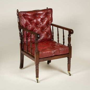 An early 19th century Scottish laburnum wood chair with a turned spindle back and buttoned red leather back and seat cushions. Circa 1840.