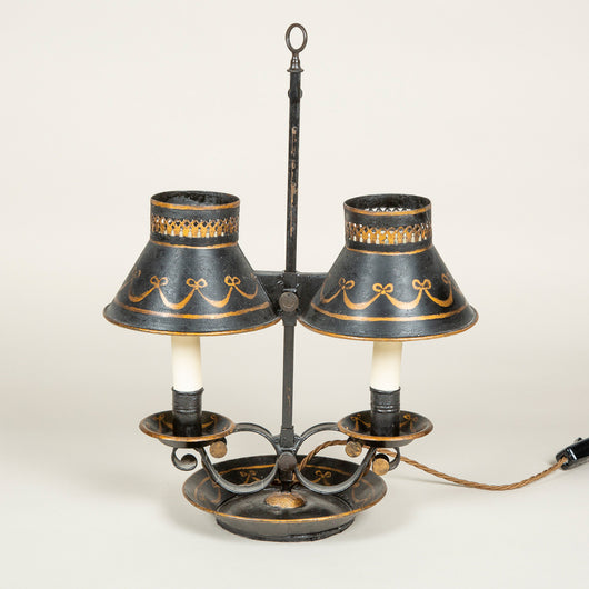 A late 19th century painted tole two candle student's lamp, now wired for electricity.