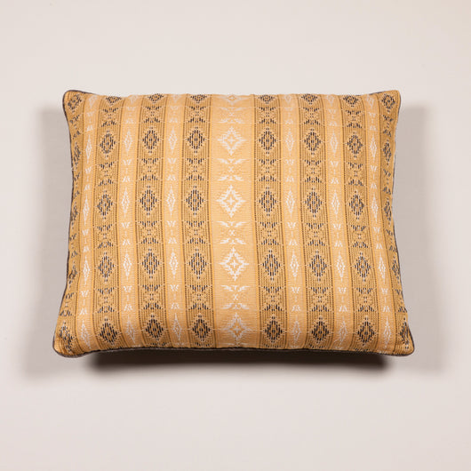 A cushion faced in a panel of hand woven fabric in a striped design on a gold ground. £750.00+ vat.