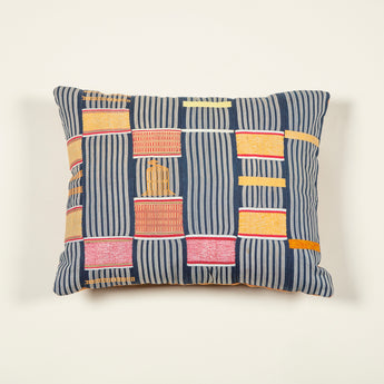 Cushions made up from a length of Kente cloth in a geometric pink, green and orange pattern on a blue ground. £295.00 each.
