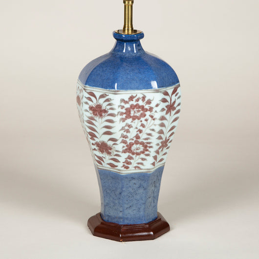 An octagonal blue-glazed Chinese vase decorated with flowerhead and foliage on a central white band, 19th or early 20th century, converted to a lamp.